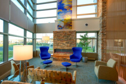 Nature in design, vibrant blue chairs with earthy elements
